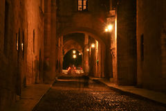 Medieval Avenue of the Knights at night, Rhodes. Medieval Avenue of the Knights at night, a cobblestone street in Rhodes Citadel , Greece Stock Image