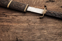 Medieval background concept. Broad sword on medieval background concept Royalty Free Stock Photo