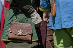 Medieval bag and accessories on people Royalty Free Stock Photo