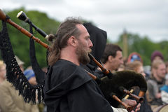 Medieval bagpipe musician Stock Photo