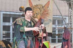 Medieval bagpipe player Stock Image