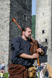 Medieval bagpiper at Castelgrande castle in Bellinzona Royalty Free Stock Photo
