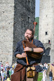 Medieval bagpiper at Castelgrande castle in Bellinzona Royalty Free Stock Images