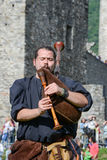 Medieval bagpiper at Castelgrande castle in Bellinzona Royalty Free Stock Image