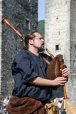 Medieval bagpiper at Castelgrande castle in Bellinzona Royalty Free Stock Photos