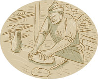 Medieval Baker Kneading Bread Dough Oval Drawing. Drawing sketch style illustration of a  baker chef cook in medieval times kneading dough bread in the kitchen Royalty Free Stock Image