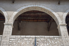 Medieval balcony. Architecture with arc and column Stock Photos