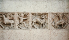 Medieval bas-relief. Medieval marble bas-relief representing mythological animals and an archer Stock Images