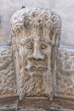 Medieval bas relief head statue Royalty Free Stock Images