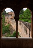 Medieval bastions seen through the castle window i. N Alhambra, Spain royalty free stock image