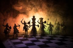 Medieval battle scene with cavalry and infantry on chessboard. Chess board game concept of business ideas and competition and stra Royalty Free Stock Images