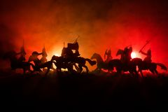 Medieval battle scene with cavalry and infantry. Silhouettes of figures as separate objects, fight between warriors on dark toned stock photos