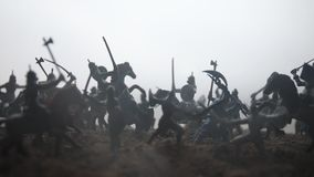 Medieval battle scene with cavalry and infantry. Silhouettes of figures as separate objects, fight between warriors on sunset stock video footage