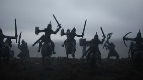 Medieval battle scene with cavalry and infantry. Silhouettes of figures as separate objects, fight between warriors on sunset stock footage