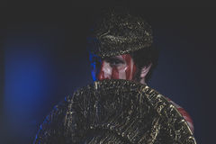 Medieval, bearded man warrior with metal helmet and shield, wild Stock Photography