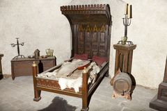 Medieval bed. Bed in a medieval palace of the Czech Republic, Prague stock photography