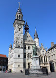 Medieval Belfry, Aalst, Belgium. AALST, BELGIUM, MARCH 17 2016: Historic buildings on the main market square in Aalst, including the medieval belfry and stock photos