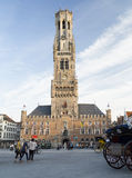 Medieval bell tower in the historical centre of Bruges. Royalty Free Stock Image