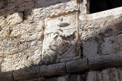 Medieval blazon on the front of the tower, Croatia Royalty Free Stock Photos