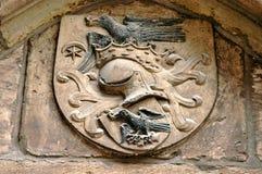 The medieval blazon of the Hunyadi (Corvin) royal family. In Hunedoara, Romania Stock Photo