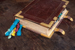 Medieval book with colorful ribbons Royalty Free Stock Photo