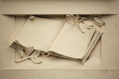 Medieval book. Stucco decoration on the Art Nouveau building Royalty Free Stock Photography