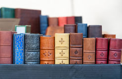 Medieval books. Handmade, with natural leather covers in antique market Stock Photography