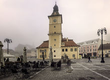 Medieval Brasov during autumn fog. Historic medieval city of Brasov, Transylvania, Romania. September 26th, 2016. The City Council now a museum. It was foggy Stock Photos