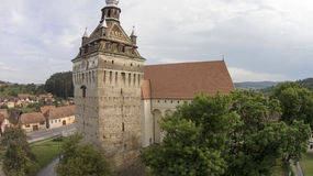 Medieval breath. Tower of a known gothic fortified church in Saschiz, Mures county Romania.Part of the villages with fortified churches in Transylvania UNESCO Stock Photos