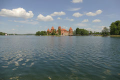 Medieval brick-built castle in Trakai on the lake. Former reside. Nce of Lithuanian princes and former capital of Lithuania. Today a very popular point of all Stock Photo