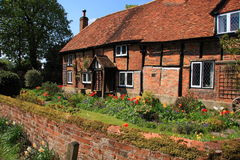 Medieval brick and timber cottage Stock Image