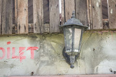 Medieval brick wall with a lamp Stock Photo