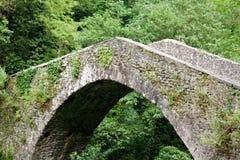 Medieval Bridge. Ancient Medieval bridge in Tuscany Stock Image