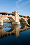 Medieval bridge. Pavia's Ponte Coperto (Covered bridge) over river Ticino. Lombardy, Italy Royalty Free Stock Photos