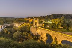 The Medieval Bridge in the ancient town of Besalu. Spain Stock Photography