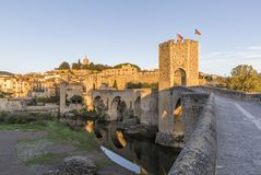 The Medieval Bridge in the ancient town of Besalu at sunrise Stock Photo
