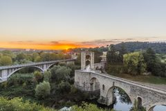 The Medieval Bridge in the ancient town of Besalu at sunrise. Spain Stock Photo