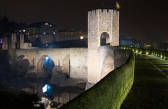 Medieval bridge with city gate. Besalu, Catalonia Royalty Free Stock Image