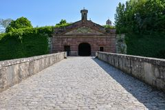 Medieval bridge leading up to the Marienberg castle in Wuerzburg. On a sunny day and blue sky Royalty Free Stock Photos