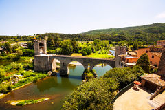 Medieval bridge with old town gate. Besalu Stock Images