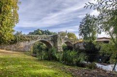 Medieval bridge over Arnoia river in Allariz, Ourense, Spain, in. Autumn Stock Images