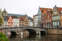 Medieval bridge over canal in Bruges Stock Images