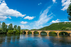 Medieval bridge over the dordogne river Stock Photography