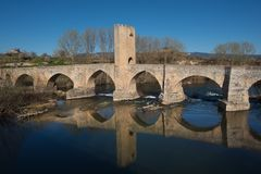Medieval bridge over Ebro river in Frias, Burgos, Spain. Royalty Free Stock Photography