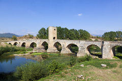 Medieval bridge over a river Stock Photography