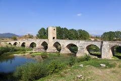 Medieval bridge over a river. Medieval bridge of Frias in Burgos, Spain Stock Photography