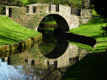 Medieval bridge in the park stock photos