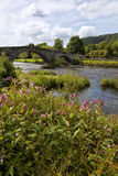 Medieval bridge Pont Fawr, old cottage, Llanrwst Royalty Free Stock Images