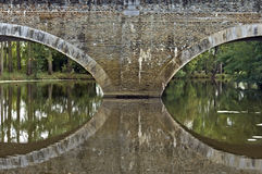 Medieval bridge on river the Evre in Loire valley Royalty Free Stock Photos