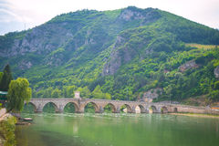 Medieval bridge on a river Royalty Free Stock Images